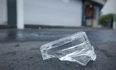 Broken glass outside the Sharland Avenue liquor store.