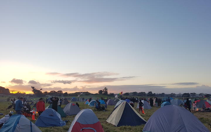 Hundreds camp at the contentious site. Photo: RNZ / Jordan Bond.