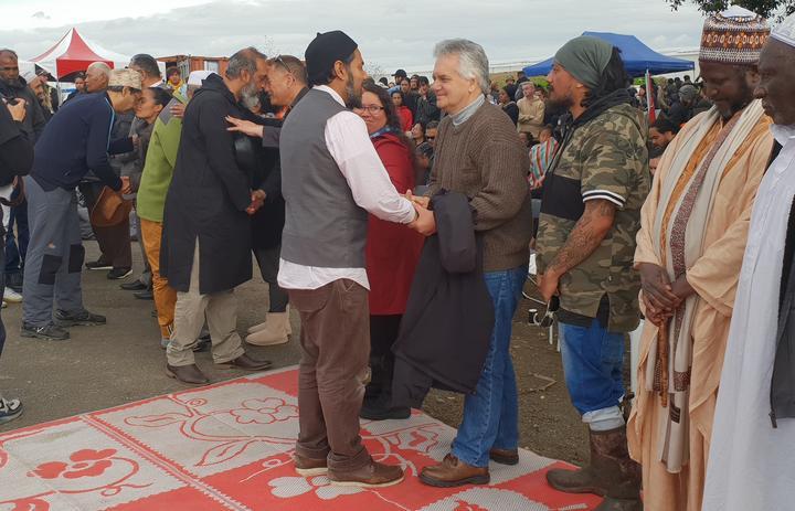 A Muslim leader greets lawyer Moana Jackson at a powhiri at Ihumātao.