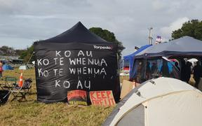 """I am the whenua, the whenua is me"": Many campers have decorated their tents with whakataukī."