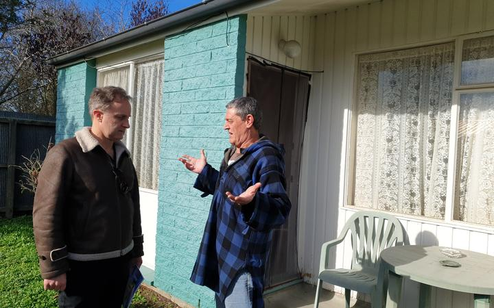 Building expert Bob Burnett talks to Frank Poissonnier at the social housing complex in Christchurch.