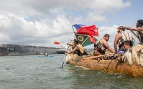 A Pacific Island canoe and a ship - Climate change demonstration