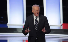 Democratic presidential candidate former Vice President Joe Biden stands on stage after the Democratic Presidential Debate at the Fox Theatre  in Detroit, Michigan.