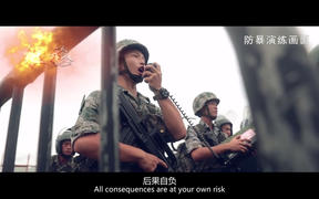 "This screengrab taken from undated handout three-minute promotional video received on August 1, 2019 from China's People's Liberation Army (PLA) Hong Kong Garrison shows PLA soldiers warning ""protesters"" during an ""anti-riot"" drill in Hong Kong."