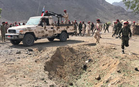 Yemeni security forces rush to the scene of a missile attack on a military camp west of Yemen's government-held second city Aden, on 1 August, 2019.