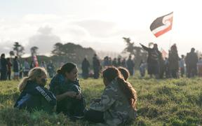Pania Newton speaks to tamariki at Ihumātao.