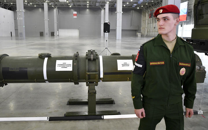 A soldier guards the Russian 9M729 missile during its demonstration to foreign military attache after Intermediate-Range Nuclear Forces Treaty (INF) briefing in the Patriot military park, outside Moscow, Russia.