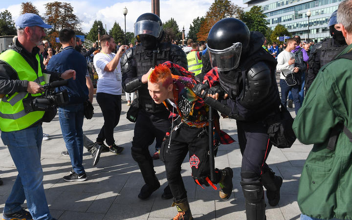 Police in Moscow detain a protester during the rally in support of the registration of independent candidates for the September's elections.