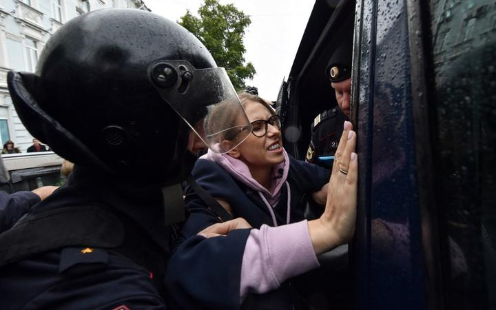 Police officers detain opposition politician, would-be candidate Lyubov Sobol on her way to an unsanctioned rally in Moscow.
