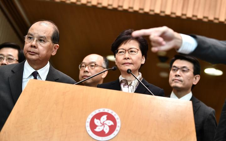 Hong Kong Chief Executive Carrie Lam (C) listens to a question during a press conference in Hong Kong.