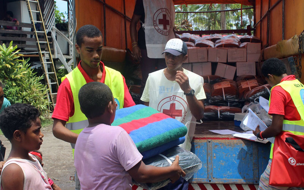 A photo taken on 25 February, 2016, and received on February 26 shows Red Cross handing out blankets in cyclone devastated Fiji.
