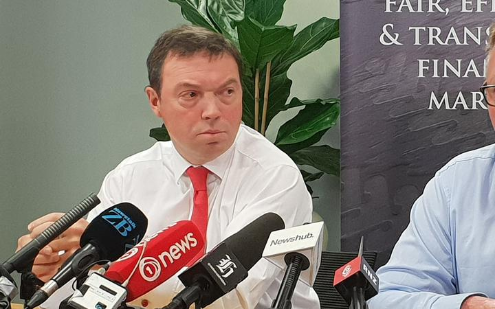 Financial markets authority head Rob Everett (left) and RBNZ Governor Adrian Orr talk about the insurance report.