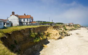 Eroded shoreline at Happisburgh, Norfolk, United Kingdom.