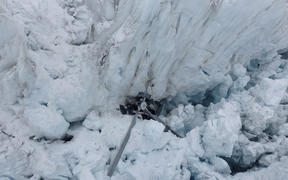High resolution image of the wreckage of a helicopter on the Fox Glacier in 2015.