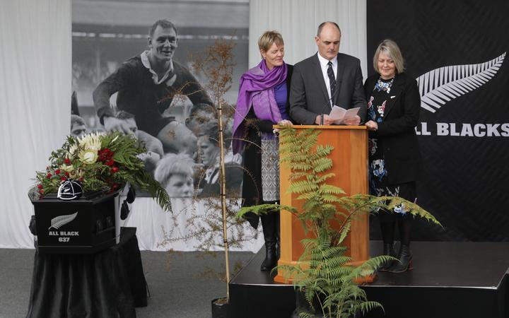 David Lochore gives a speech at his father's funeral.