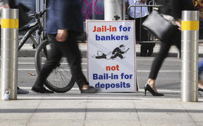 A photo taken in Melbourne on April 23, 2018 show a placard outside the royal commission set up in February to investigate misconduct in the banking sector.