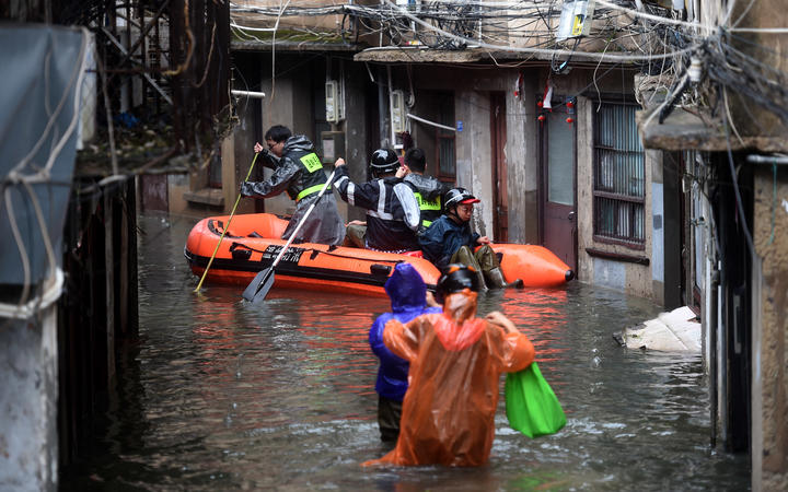 One million evacuated as deadly typhoon hits China