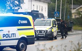 Police vehicles near Norway's al-Noor Islamic Center mosque where a gunman opened fire.