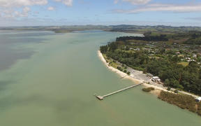 Kaipara Harbour looking back towards Parakai with Shelly Beach wharf in the foreground.  South Head, New Zealand