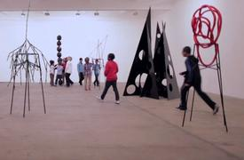 Boys and sculpture - a screen shot from an early section of Eva Rothschild's video before the sculptures are dismantled curing the course of the boys' boisterous play.