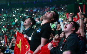 LGD fans react during the Dota 2 grand final match between PSG.LGD and OG on Day 6 of The International 2018 at Rogers Arena on August 25, 2018 in Vancouver, Canada.