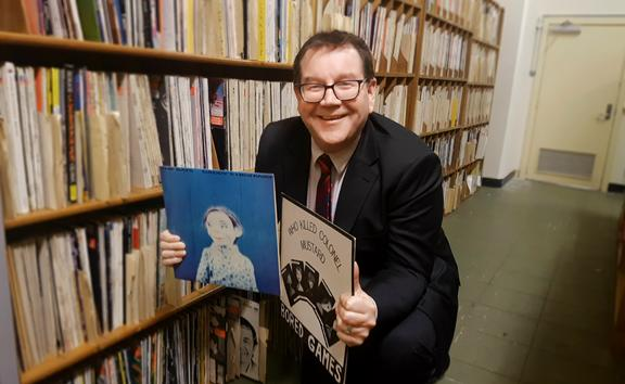 Minister of Finance and Flying Nun fanboy Grant Robertson amongst the RNZ local vinyl archive
