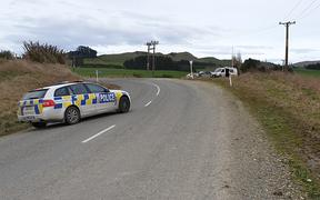 Police at Mountain Road near Gore on Friday 16 August.