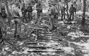 Australian troops with weapons at Long Tan in 1966