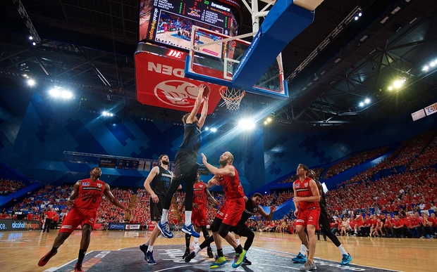 Thomas Abercrombie of the New Zealand Breakers drives for a dunk.