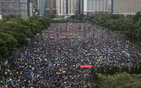 Protesters gather for a rally in Victoria Park in Hong Kong on Sunday in the latest opposition to a planned extradition law that has since widened into a call for democratic rights in the semi-autonomous city.