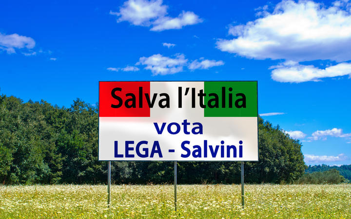 An election billboard which says the only hope for saving Italy is to vote for Matteo Salvini's Northern League party.