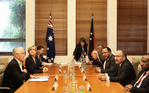 Australian Prime Minister Malcolm Turnbull and his cabinet colleagues (left side of table) meet with his PNG counterpart Peter O'Neill and members of his National Executive Council.