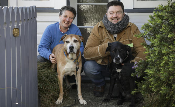 Dogs Charlie and Betty with their owner Katherine Short, and borrower Justin Meade