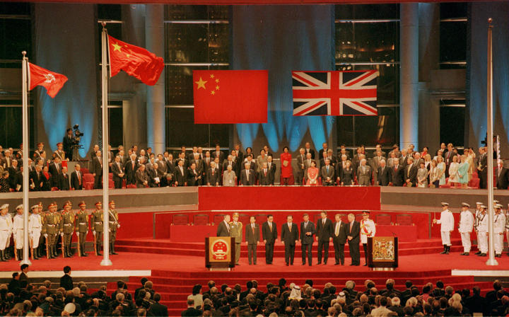 Chinese and British leaders attend the Hong Kong handover ceremony held on 1 July, 1997.
