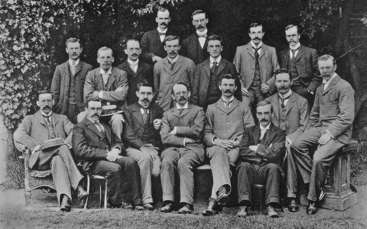 British physicist JJ Thomson with his research students at Cambridge, in 1898. Ernest Rutherford fourth from left in middle row.