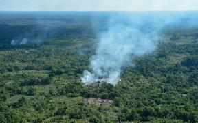 Smoke rises from the forest in a region of the Amazon near the Colombian border.