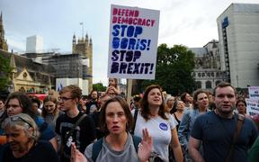 Anti-Brexit demonstrators march from Britain's Houses of Parliament to Downing Street in protest at Prime Minister Boris Johnson's announcement that Parliament will be suspended for more than a month.
