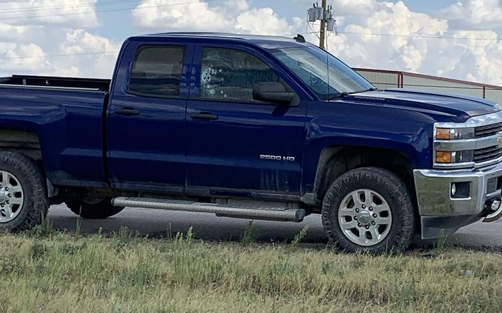 This handout images obtained courtesy of Ernst Villanueva taken on August 31, 2019 show a car with multiple bullet holes on the windows after a gunman open fire in the I-20 highway in between Odessa and Midland, Texas.