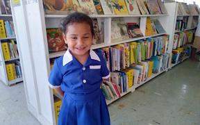 A local child in Kolovai village is excited about the opening of Tonga's first public library.
