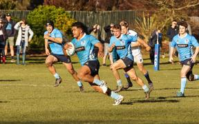Siua Maile runs the ball up for his Shirley club in Christchurch