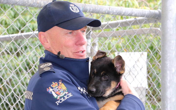 Senior Sergeant Chris Best with police dog puppy London