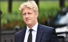 (FILES) In this file photo taken on June 20, 2019 Conservative MP Jo Johnson, former minister and brother of leadership contender Boris Johnson, is seen at the Houses of Parliament in London on June 20, 2019.