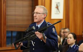 Mike McIlraith is the officer in charge of the Arms Act service delivery group with an AR15 military style rifle.