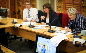 National MPs Nicky Wagner (right), Denise Lee, (center) and Stuart Smith (left) talk Star Trek in their Maori for MPs class at Parliament.
