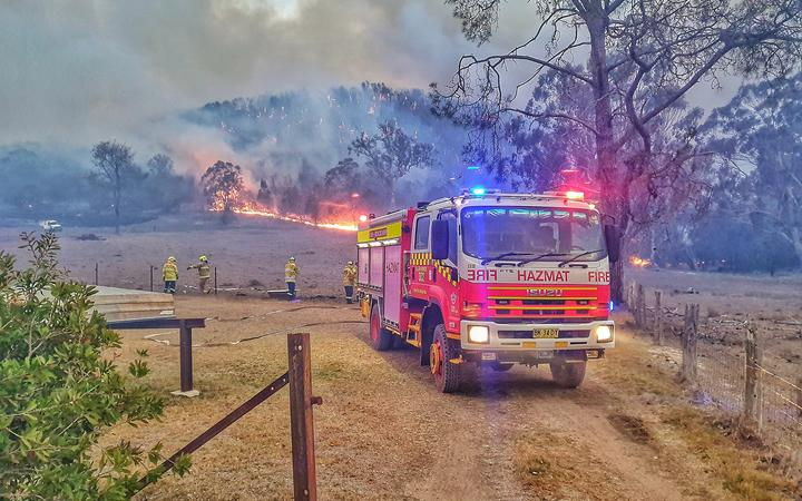 Crews battle two huge fires threatening south Queensland towns