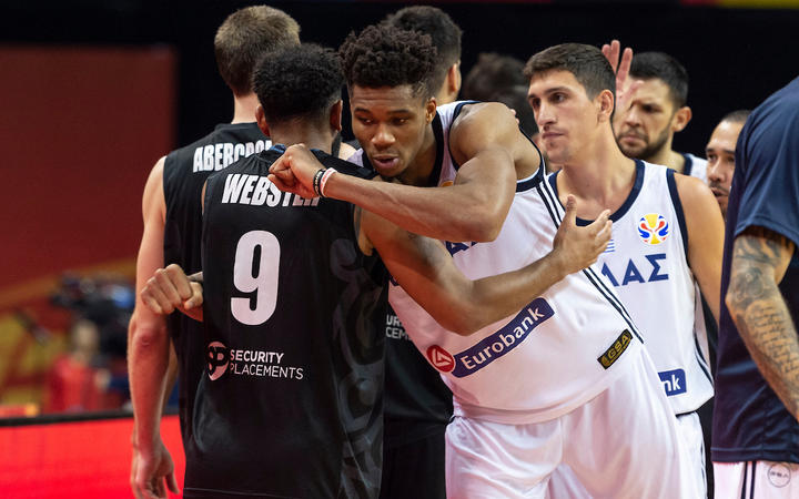 hooting Guard, Corey Webster is given a respectful hug at the end of the match by Greece's Giannis Antetokounmpo.