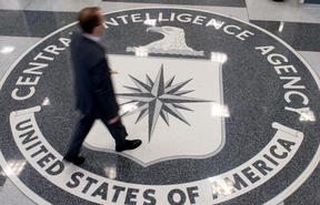 (File) A man crosses the Central Intelligence Agency (CIA) seal in the lobby of CIA Headquarters in Langley, Virginia, in 2018.