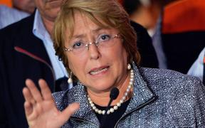 President Michelle Bachelet was moved to higher ground while visiting the damaged city of Arica.