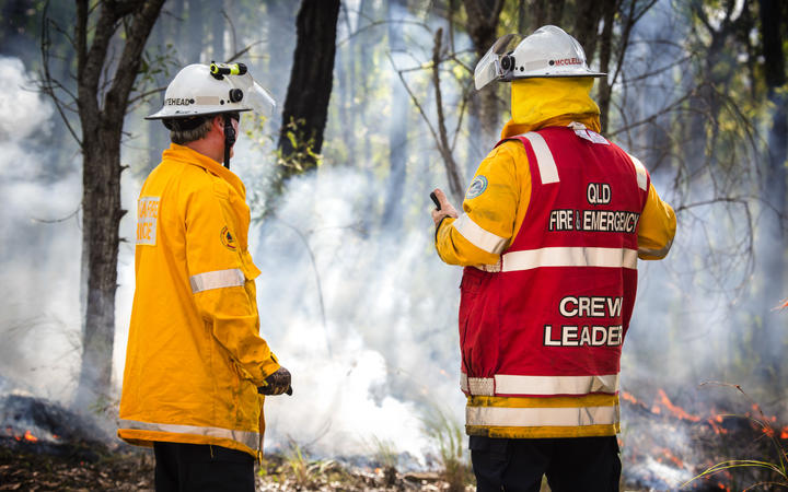 Schools close as battle to contain Queensland blazes