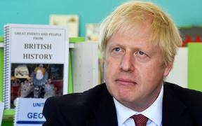 Boris Johnson, pictured on a visit to year six pupils at Pimlico Primary in London on Sept 10.